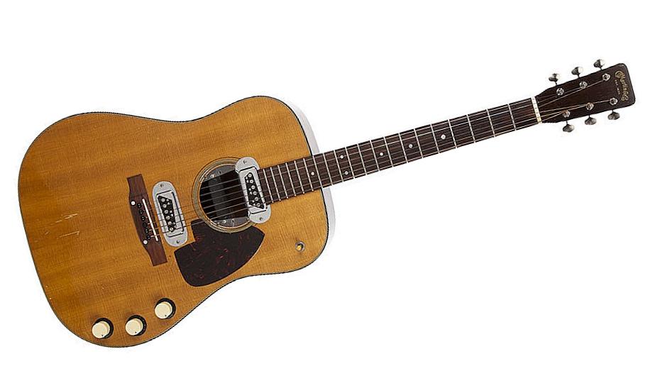 Kurt Cobain's 'MTV Unplugged' guitar sells for $6 mln at ...