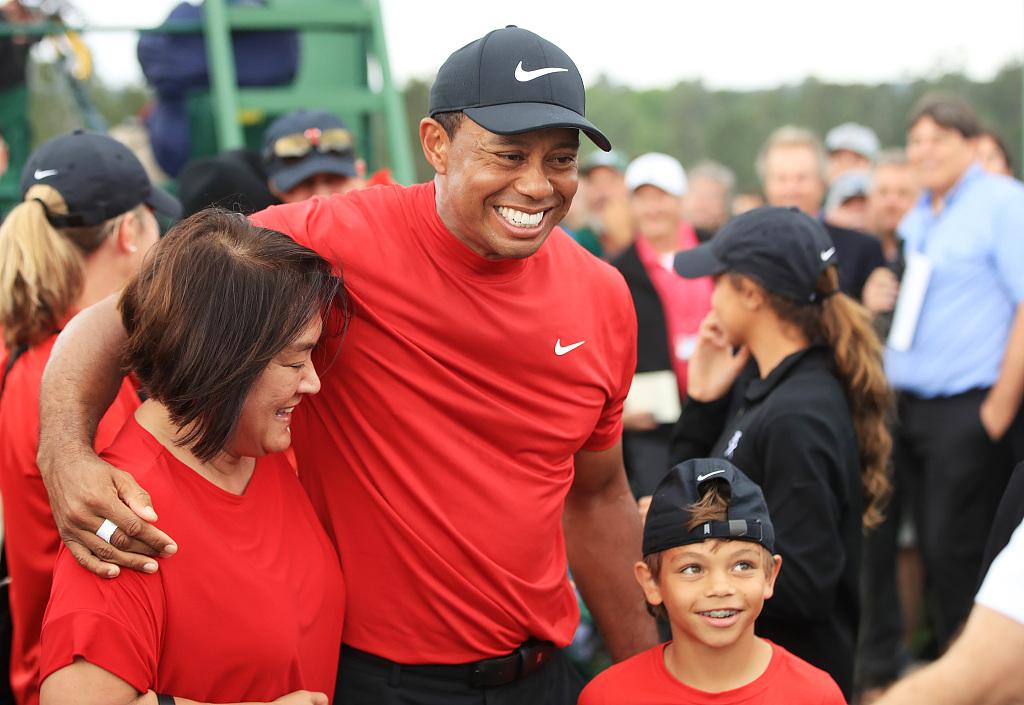 Tigers Woods caddies as son Charlie wins junior tournament - CGTN