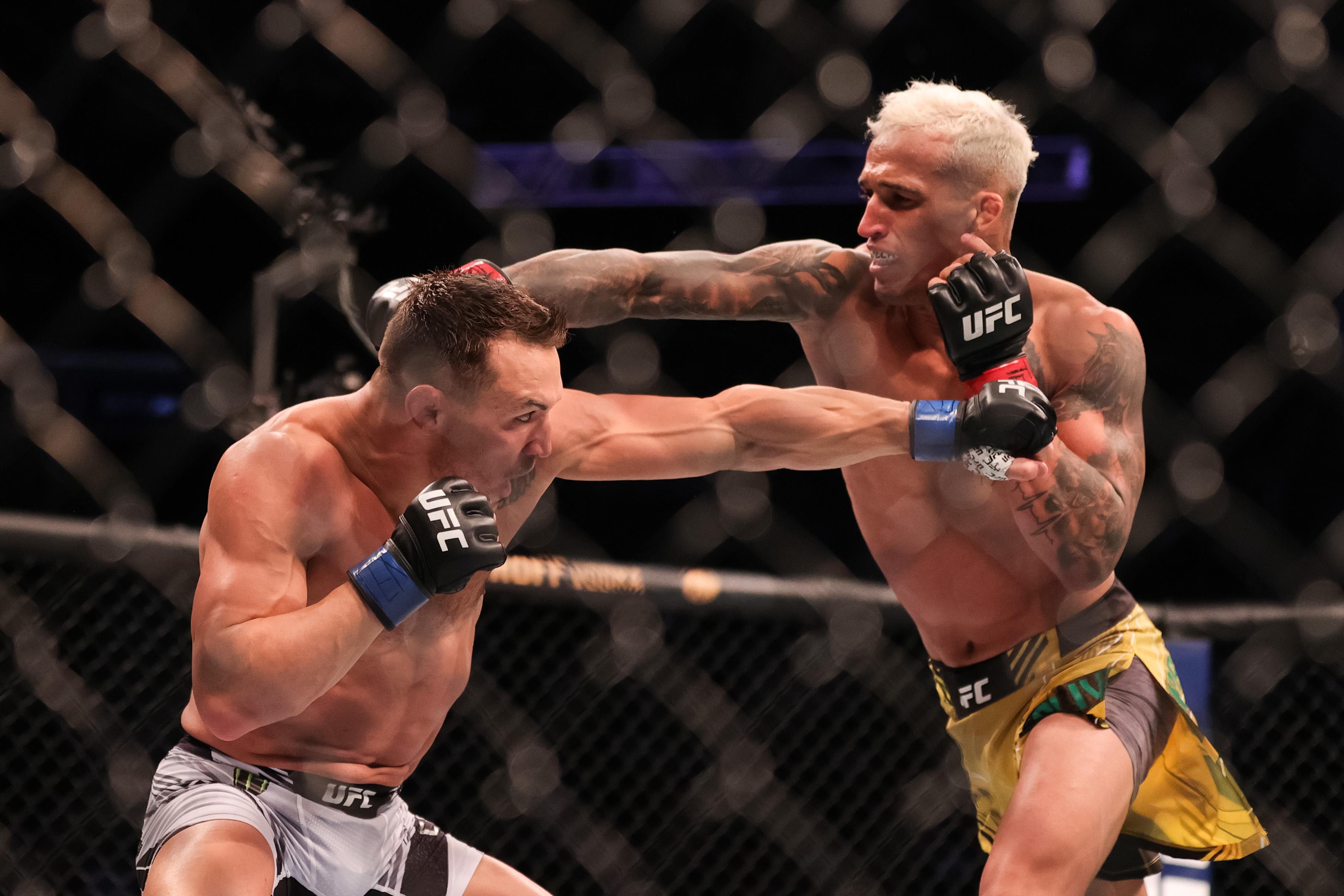 UFC 262: Oliveira ushers in new lightweight era with Chandler finish - CGTN