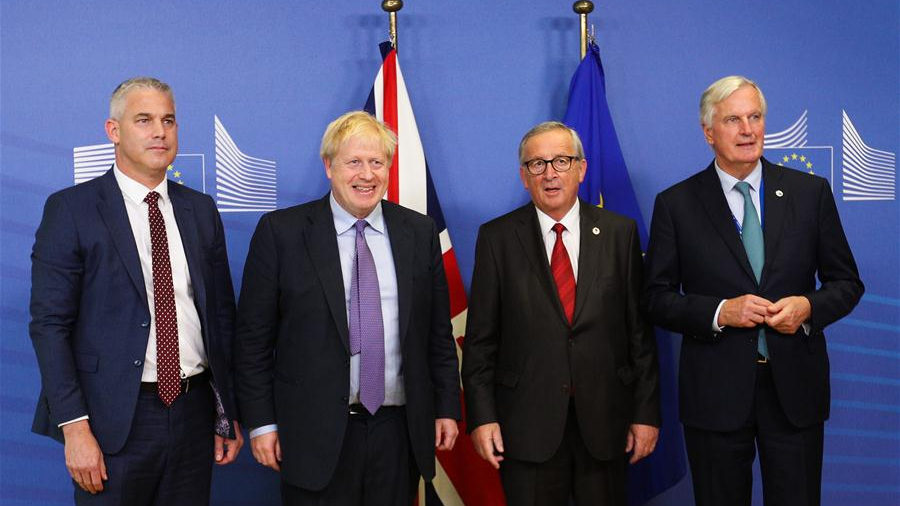 The UK and EU negotiators joined PM Boris Johnson and European Commission chief Jean-Claude Juncker to pose for photographers