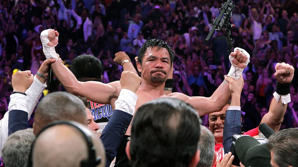 Boxing champ Pacquiao launches his own cryptocurrency - CGTN