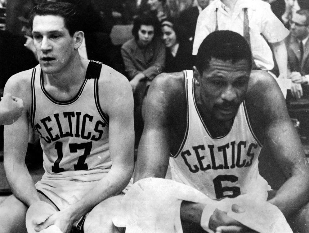 93e28cb3740 John Havlicek #17 and Bill Russell #6 of the Boston Celtics take a break on  the bench in the game against the Philadelphia 76ers, April 15, 1965. /VCG  Photo