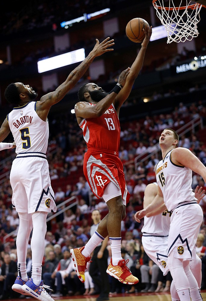 788f90078398 James Harden  13 of the Houston Rockets shoots in the game they win against  the Denver Nuggets 112-85 at the Toyota enter