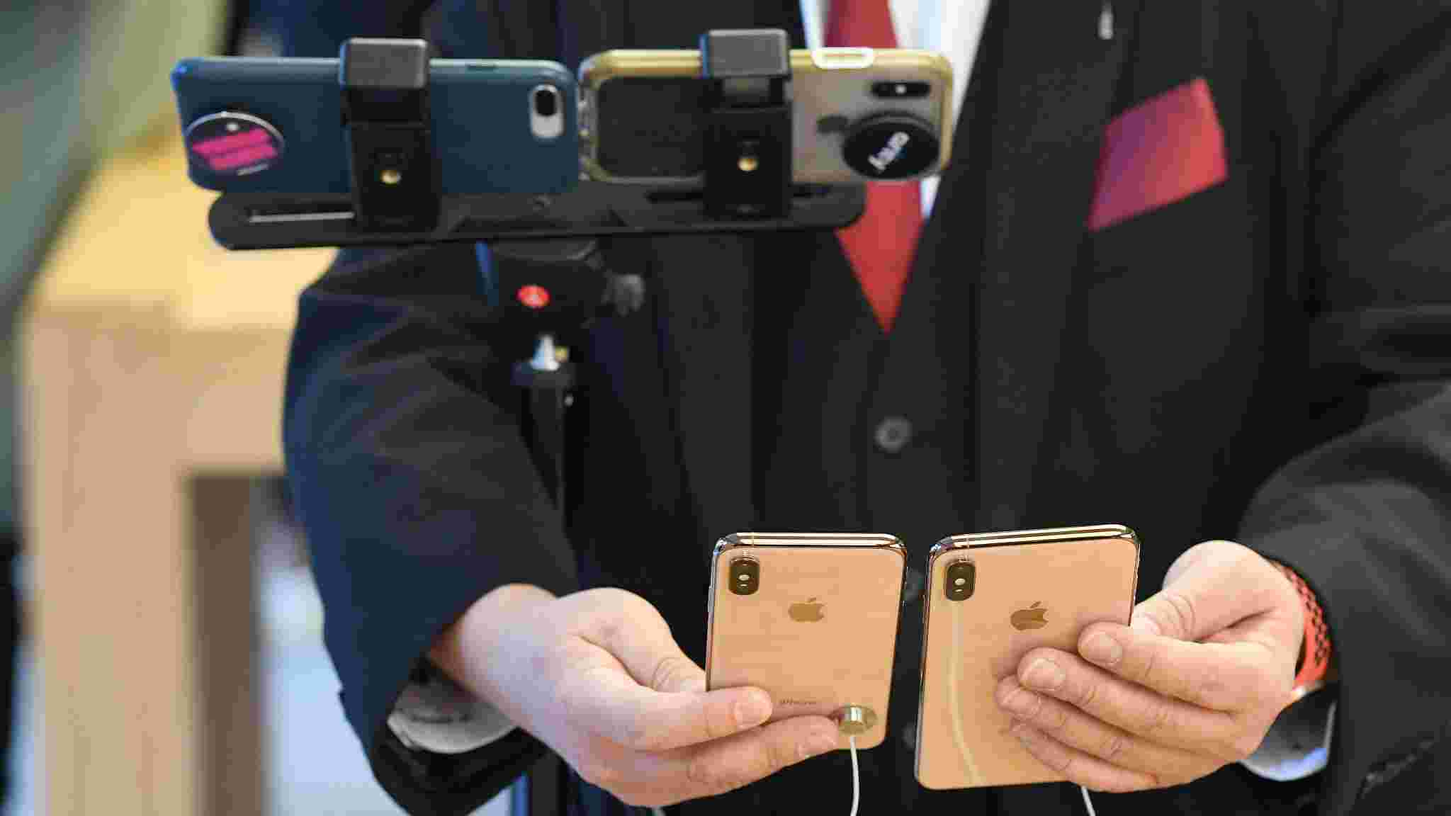 398c861fa59 A journalist uses two iPhones to film two of the new iPhones at the  Australian release of the latest iPhone models at the Apple Store in  Sydney