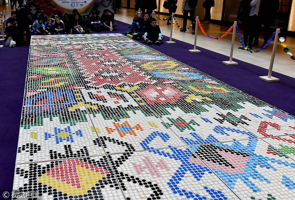 A colorful giant carpet made of plastic bottle caps was exhibited at the Sarajevo City Center shopping center in Bosnia to commemorate International ...
