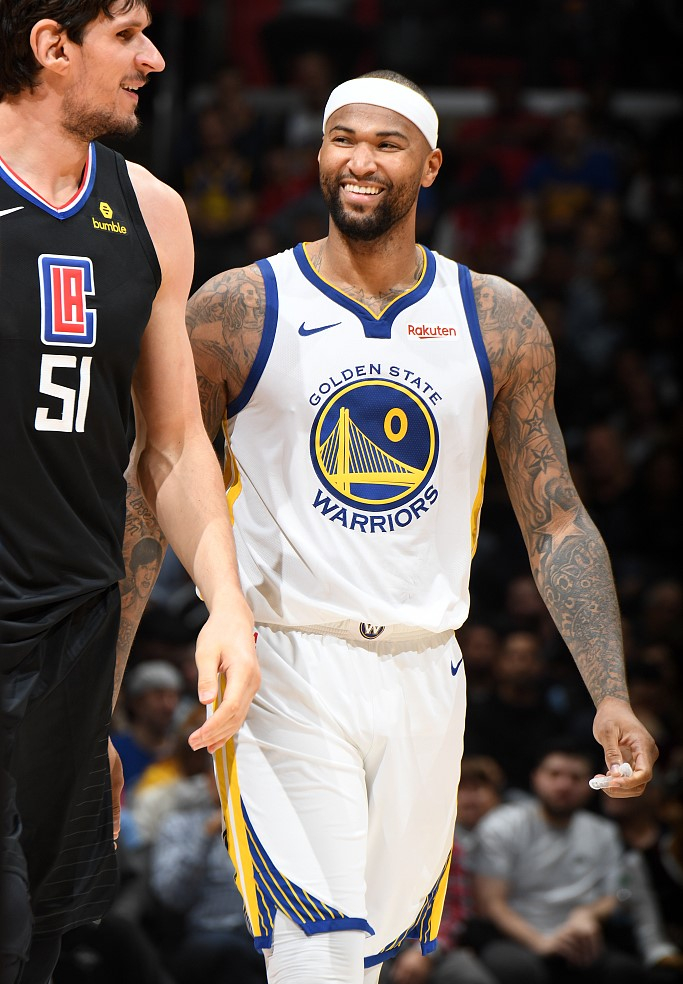 DeMarcus Cousins  0 of the Golden State Warriors talks to Boban Marjanovic   51 of the Los Angeles Clippers during their game at the Staples Center. 3ca0d0d0a