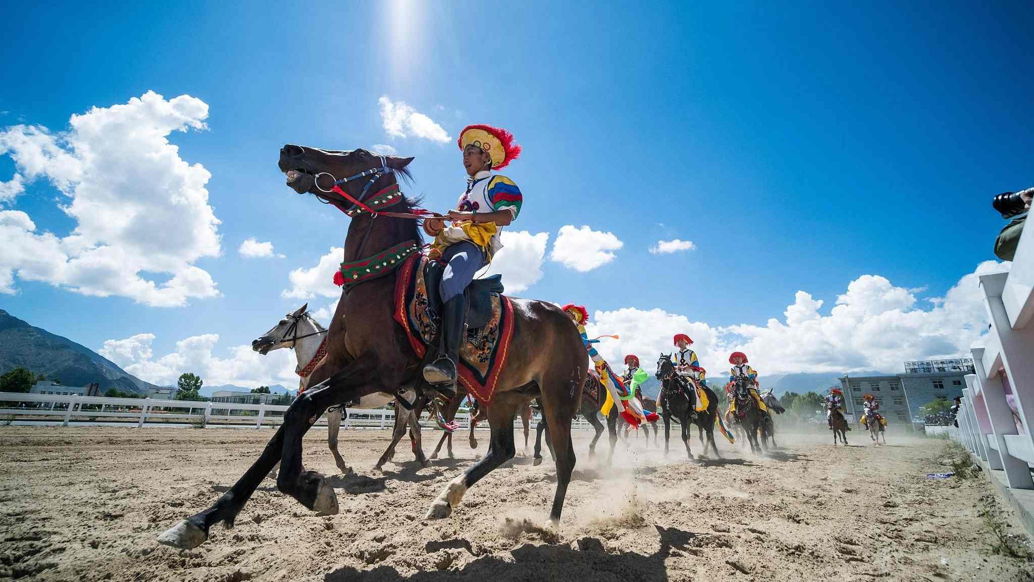 Horse riders perform stunts during Shoton Festival - CGTN
