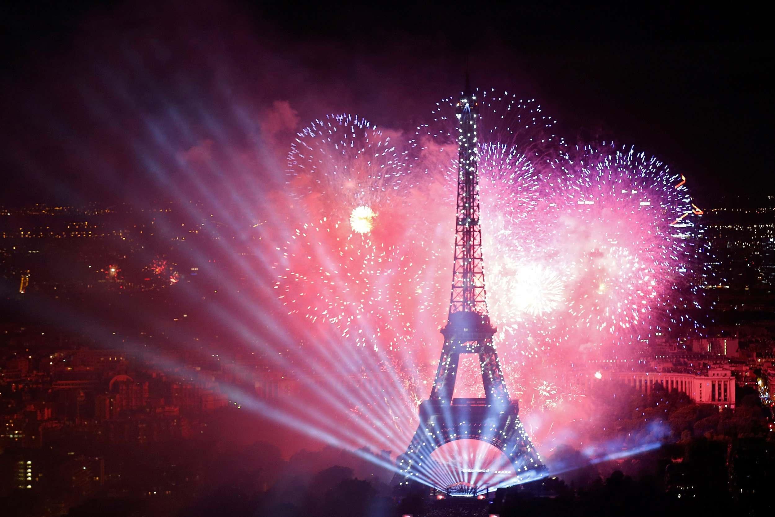 bastille day fireworks illuminate the eiffel tower - cgtn