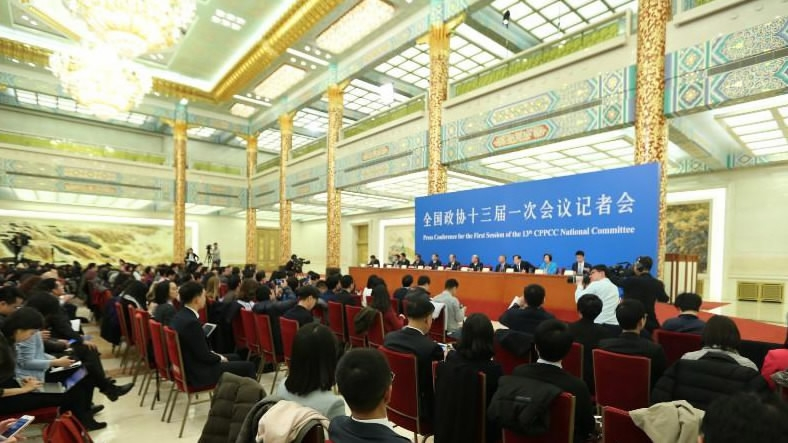 CPPCC members brief reporters on democratic parties' participation in political activities